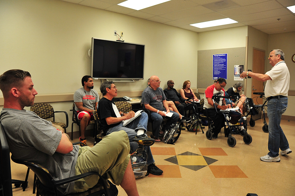Peer Support Specialist DeWayne Raulerson routinely shares his personal story of recovery with fellow Veterans at the Tucson VA. Photo by Clifford Baser